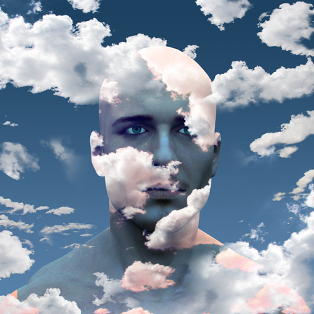 Mans head in clouds photo