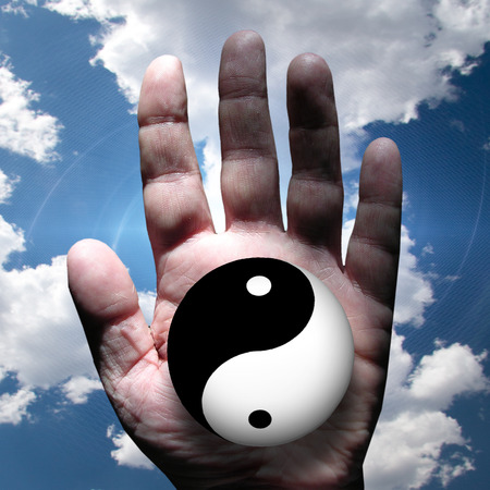Hand clouds and Yin Yang Stock Photo - 25633810
