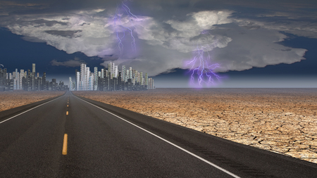 Stormy sky on desert road leading into city photo