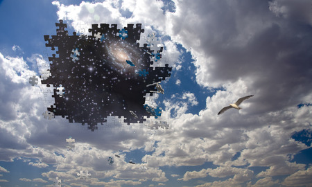 Puzzle piece daytime sky reveals night sky photo