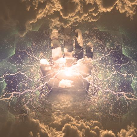 Lightning radiates from palm of hand photo