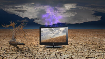 contrasting: Flat Panel with fields of grain in desert Stock Photo