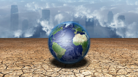 dryness: Earth sits in dried cracked mud before metropolis Stock Photo