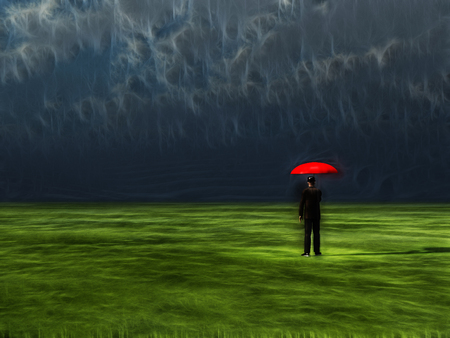overlooking: Man with red umbrella under gathering storm Stock Photo