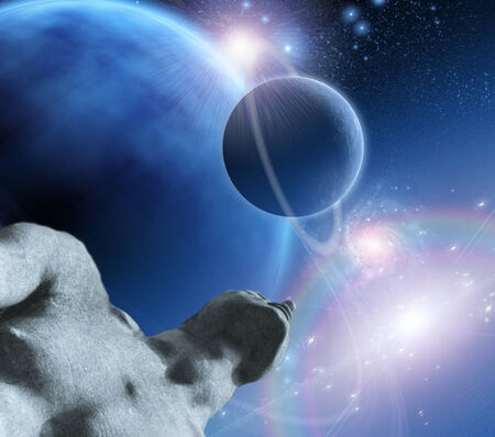 moons: Statue of man gazing upward to the sky of ringed planets Stock Photo