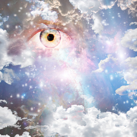 Eye in bright nebulous clouds and stars 스톡 콘텐츠