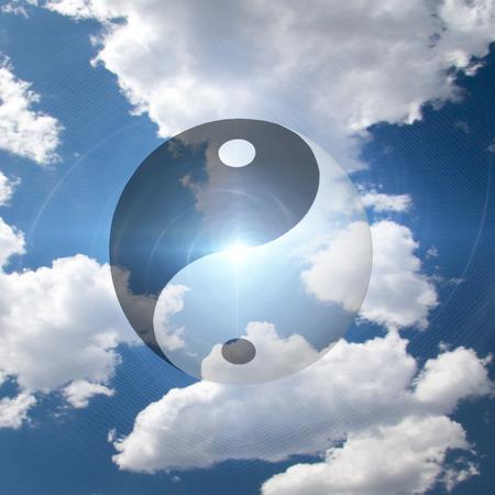 symbol: Yin Yang Symbol in Clouds Stock Photo