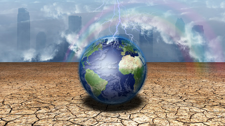 infertile: Earth sits in dried cracked mud before metropolis Stock Photo