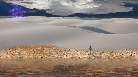 Man stands before vast desert landscape photo