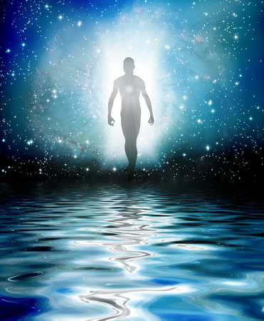 celestial: Human Figure Emerges from Light Stock Photo