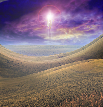 appear: Figure of Light Appears in Sky over Beautiful Landscape Stock Photo