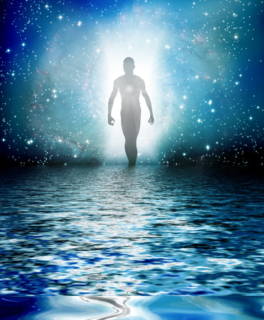 spiritual background: Human Figure Emerges from Light Stock Photo