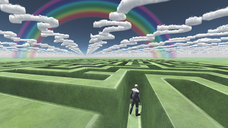 puzzling: Man in maze with question mark shaped clouds