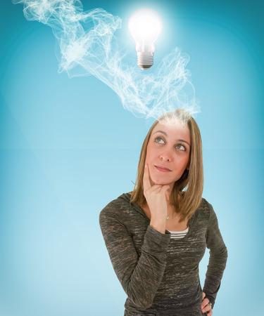 thinking woman: Young Woman Thinking Stock Photo