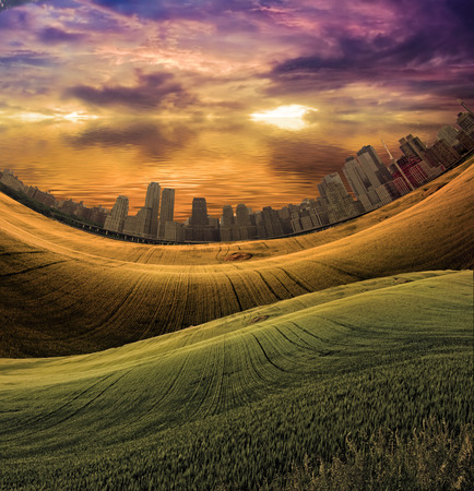 City in distance and meadow abstract background