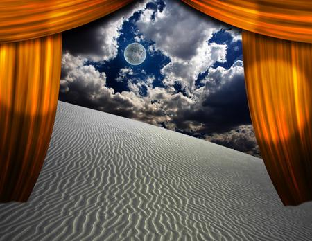 limelight: Desert sands seen through opening in curtains