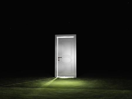 mysterious: Single door emits light in dark scene