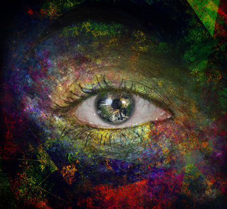 Surrealism. Womans eye with galaxies. Stock Photo
