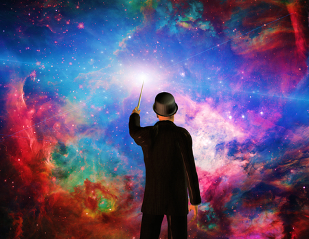 creates: Man in suit with magic wand creates universe.