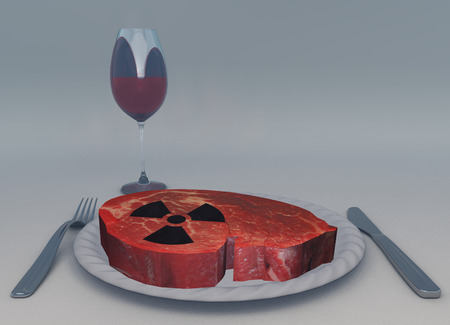 Raw meat and glass of wine. Radiation sign.