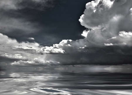 Dramatic clouds reflected in water surface