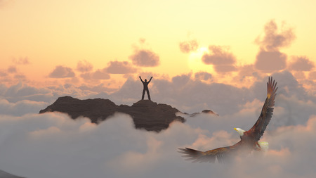 Man on a mountain peak. Eagle flies above clouds. Stock Photo