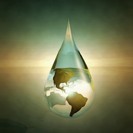 Water drop with earth inside. Stock Photo