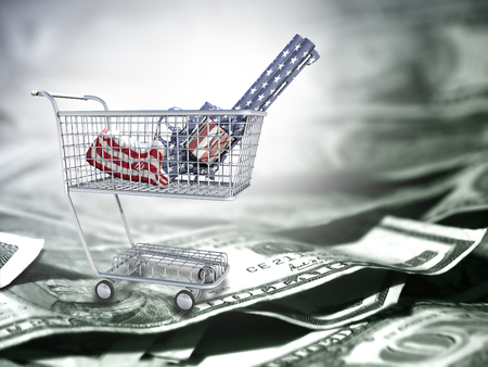 Gun in national colors in a cart. US dollars.