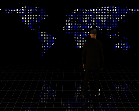 Man in suit stands before world map Фото со стока