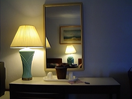 Table lamp on bedroom table and mirror