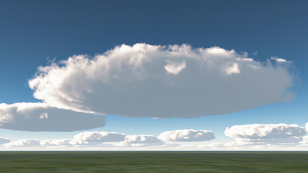 Surreal round clouds above green field