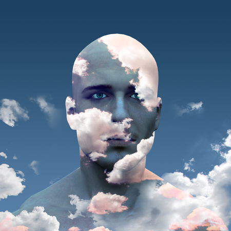 Mans head in clouds
