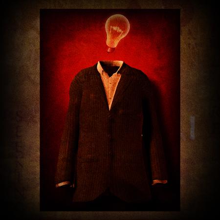 Symbolic composition. Men suit and light bulb Imagens
