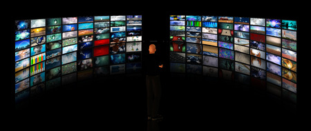 Man viewing video displays. Media gallery or surveillance