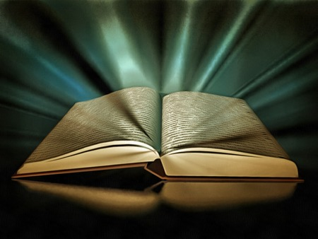 Open book with rays of light.