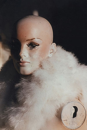 Woman mannequin without hand wears fur