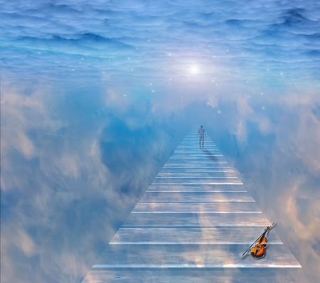 Musical path. Violin and man on a sky road Archivio Fotografico