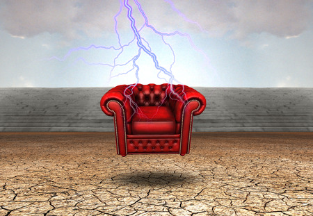 Red armchair in arid land. Lightning strike in the sky