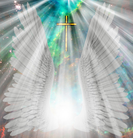 Angels Wings. Spiritual composition. Shining light and christian cross Stock Photo