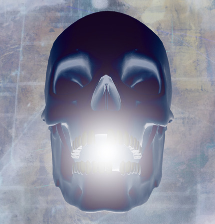 Human skull with glowing light Stock Photo