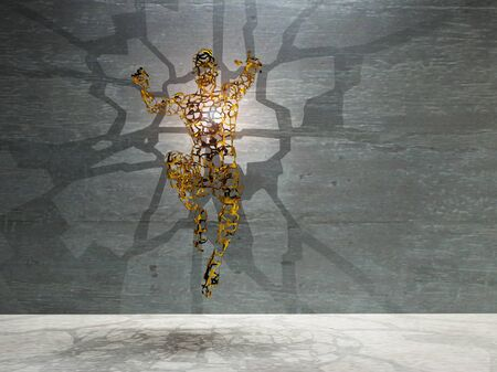 Men's figure made of gold with light rays