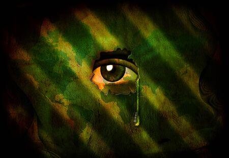 L'œil regarde à travers le mur avec des larmes
