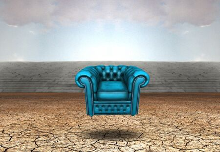 Surrealism. Blue armchair in arid land
