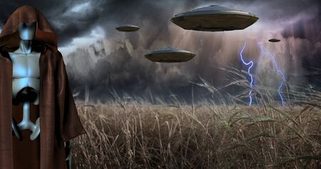 Alien Invasion. UFOs in storm clouds 免版税图像