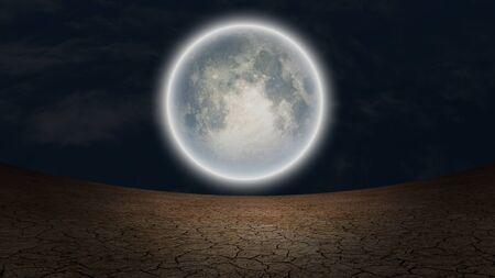 Surrealism. Full moon over arid land.