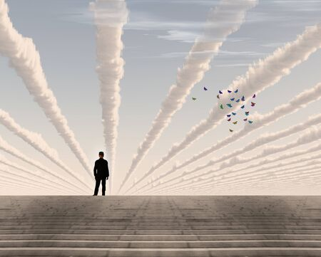 Man in black suit on top of stone stairs. Butterflies and surreal clouds in the sky Imagens