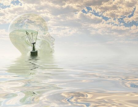 Light bulb in form of human head looks out over water landscape Banco de Imagens