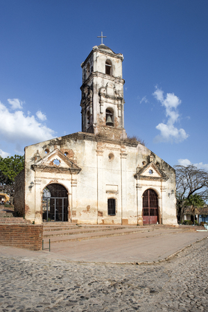Cuba, Trinidad: Street scene with facade of famous ancient old Church (Iglesia de Santa Ana) in the center of the Cuban small town. February 08, 2015