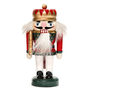 Merry Christmas: Traditional colorful vintage wooden nutcracker doll puppet in red uniform isolated on white background and copyspace for text - concept tradition festive Christmas decoration