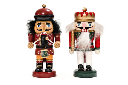 Merry Christmas: Two traditional colorful vintage wooden nutcracker puppets in uniform isolated on white background and copyspace for text - concept tradition festive Christmas decoration ornament Фото со стока - 111577042